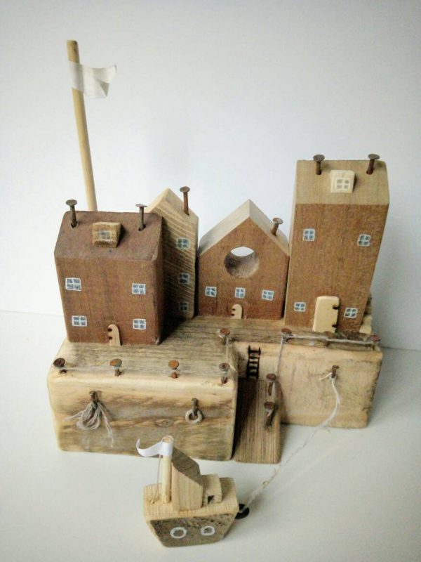 wooden cottage with boat for kids